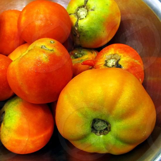 Heirloom tomatoes in aluminum bowl photo