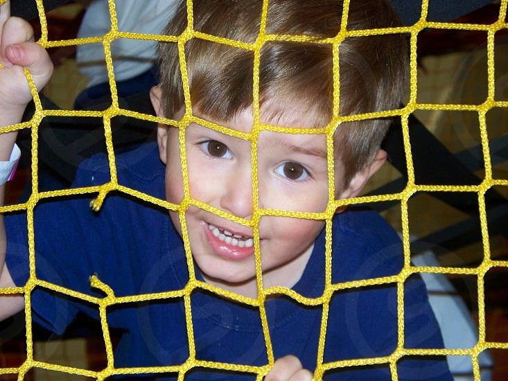 boy fun indoor bounce house party net photo