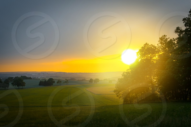 Sunset over a field photo