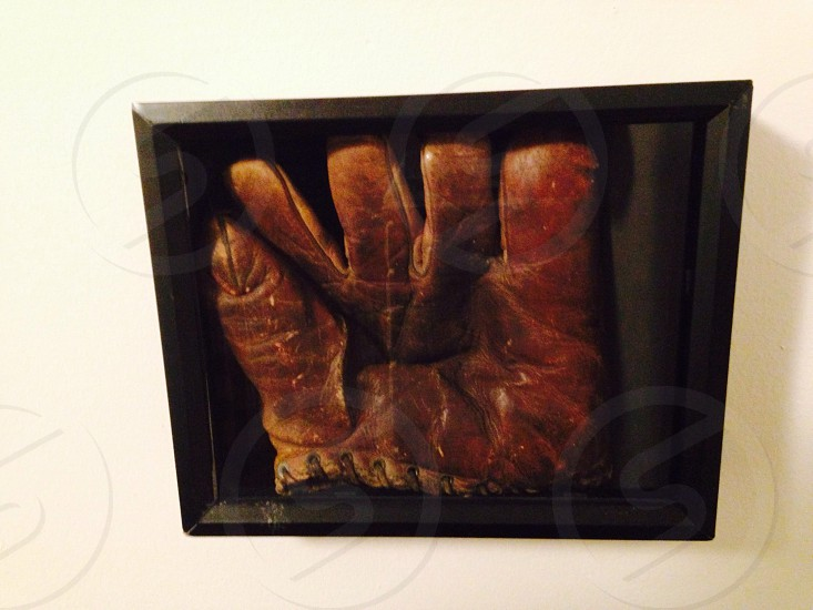 framed brown leather glove photo