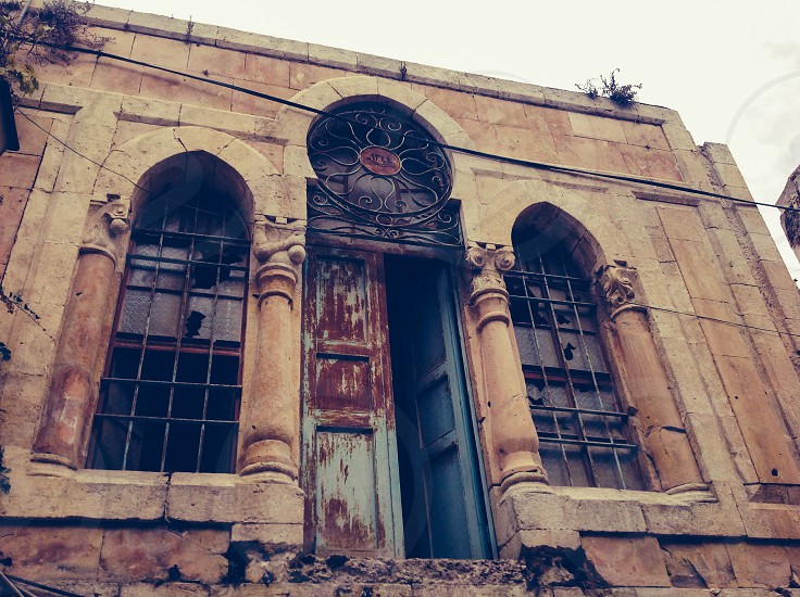 Old door in empty house in ghost town Hebron Palestine  photo