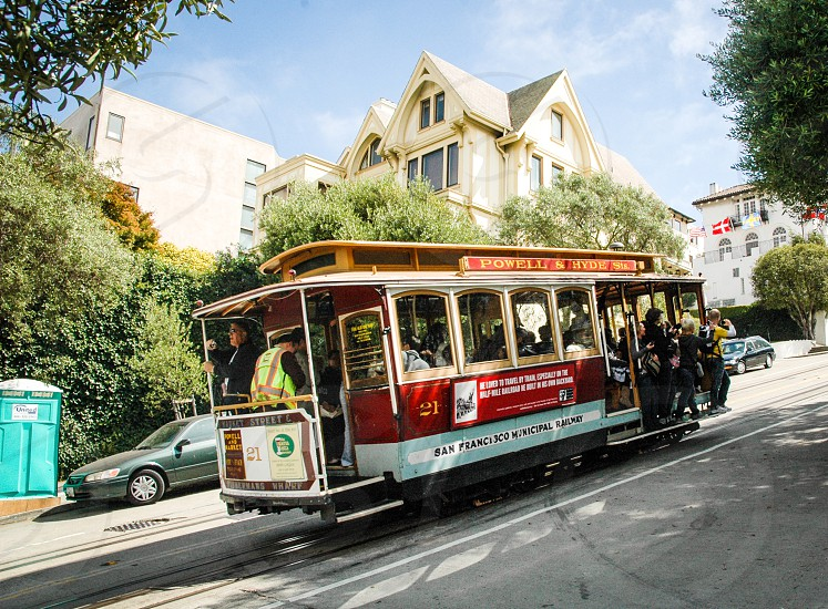 Busy San Francisco cable car passing by on a sunny day photo