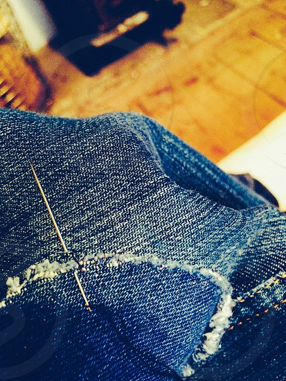 Patching up a pair och jeans thread and needle denim jeans up-cycling photo