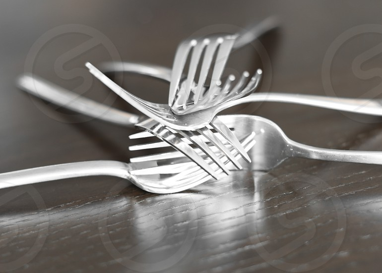 Forks stacked on wood table photo