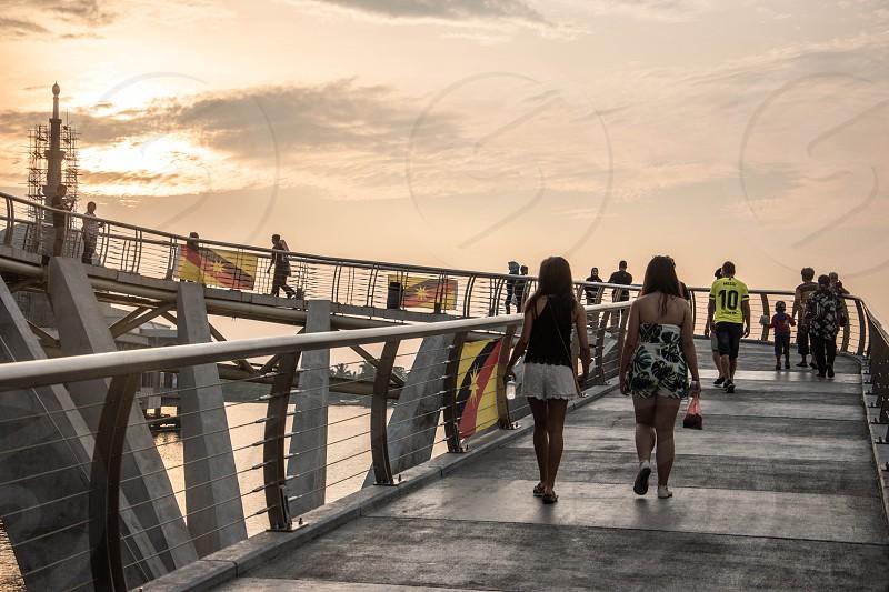 Walking up the Darul Hana Bridge Kuching Sarawak Malaysia. photo