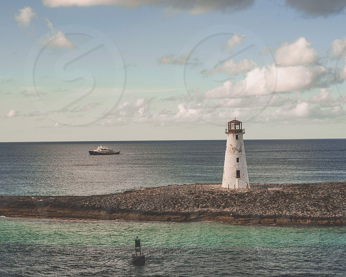 Lighthouse boat bay ocean cruise ship  photo