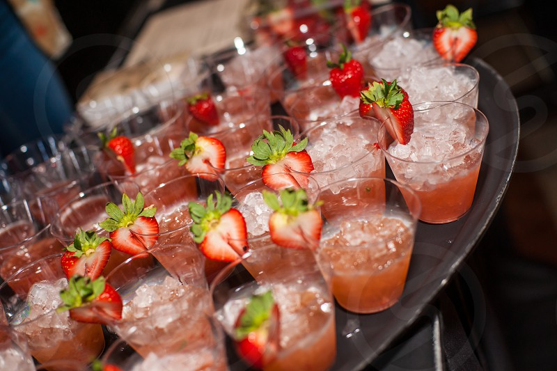 slice strawberry fruit on clear drinking glass photo