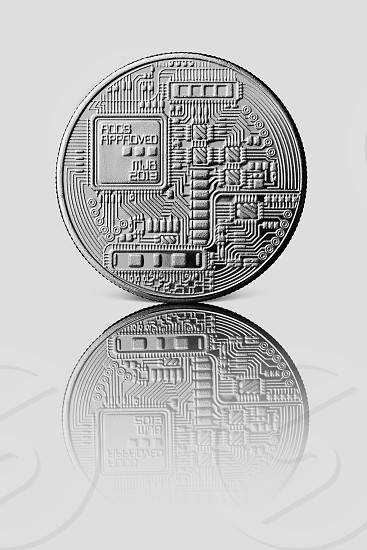 Silver Bitcoin. Back of the coin. Reflection of a coin on a gray glossy background. Cryptocurrency and blockchain trading concept. photo