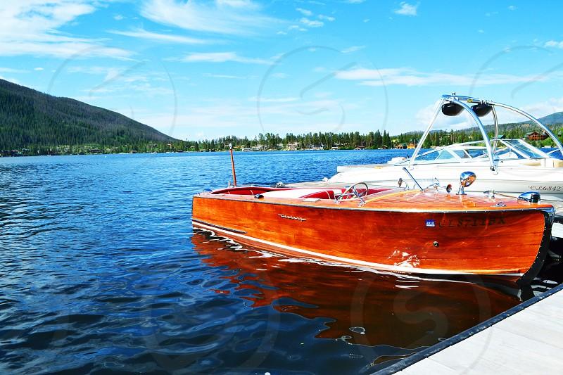 Boat on Lake near Mountains photo