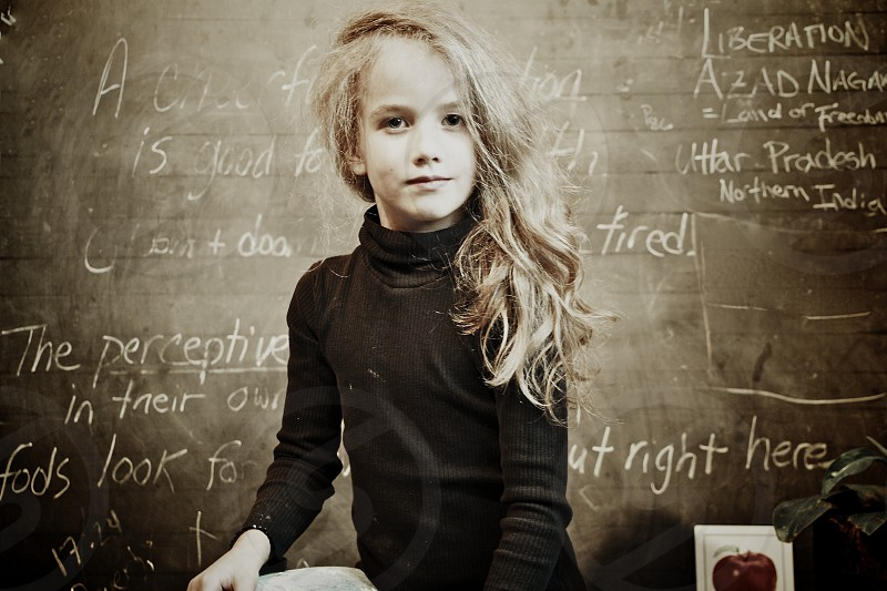 Young Student at Chalkboard learning about the World photo