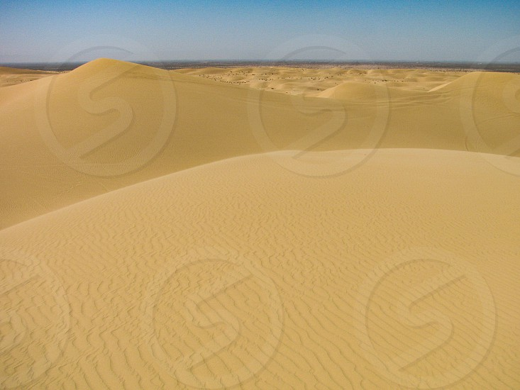 The Algodones Dunes field in southern California also called Imperial Sand Dunes formed in the Sonoran Desert by wind erosion of deposits from an ancient lake. photo
