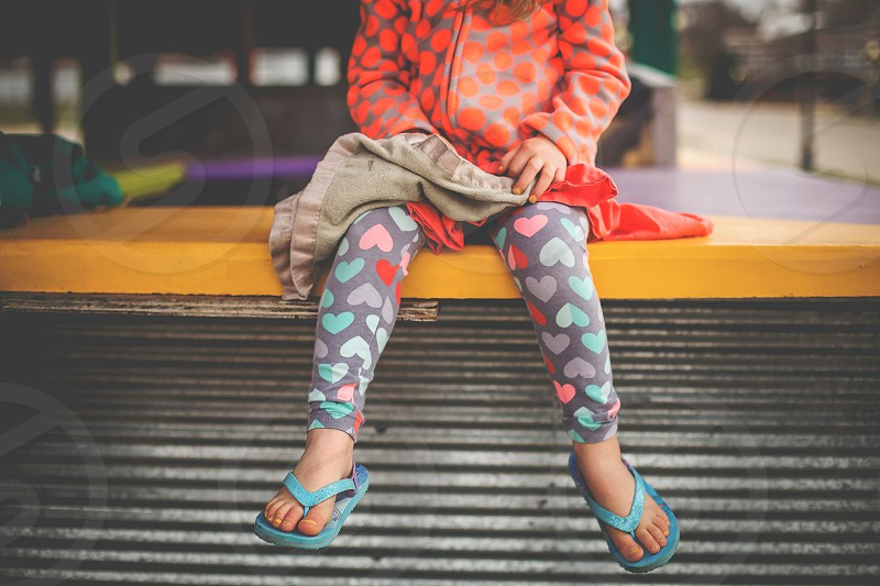 child girl waiting sitting colorful colors sandals flip flops photo