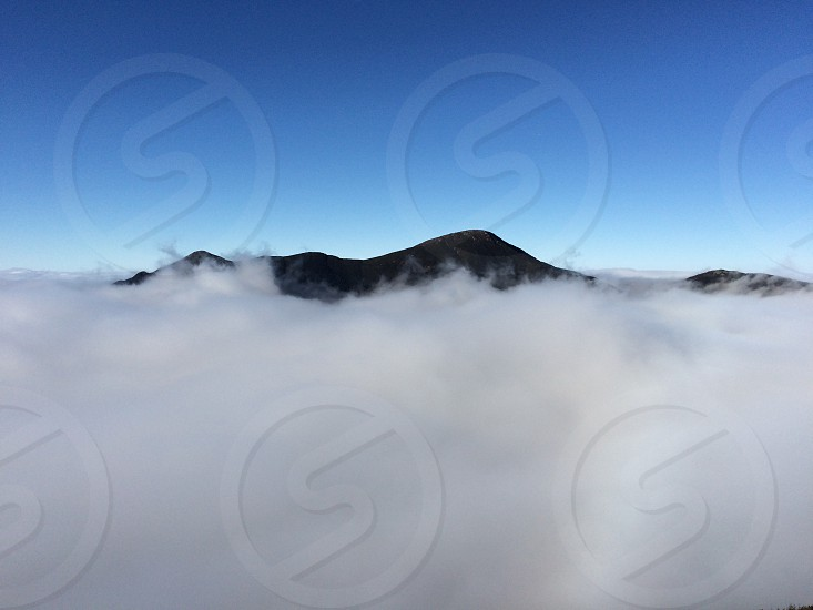 Left Iroquois mountain. Right Algonquin mountain. High peaks 46er. A over the clouds. Winter hiking.  photo