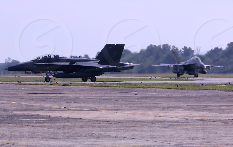fighter aircraft of Royal Malaysia Airforce on taxing into the hanger. photo