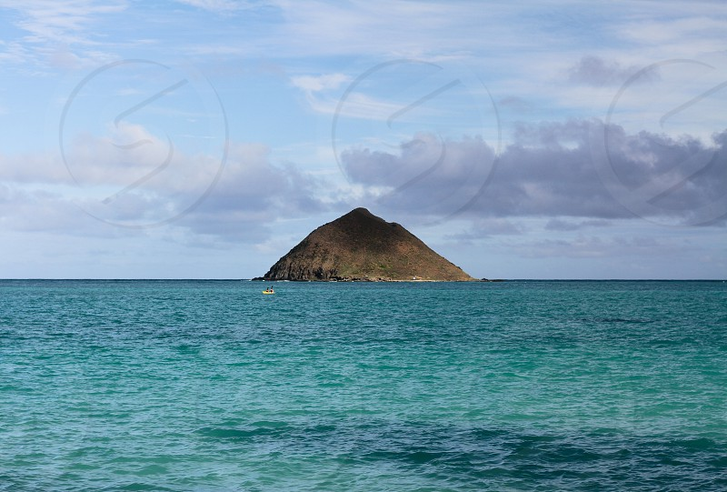 A couple kayak back from one of the Twin Islands off the shore of Lanikai Beach Oahu HI photo