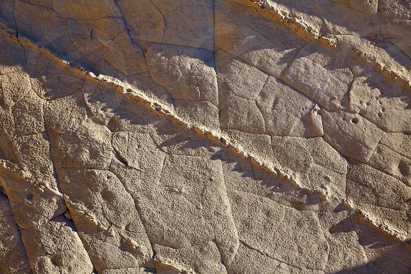 Javea Xabia Cala Blanca rock texture in Alicante Spain photo