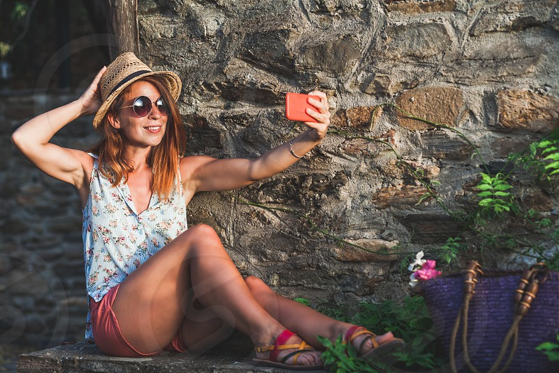 Tourist woman taking travel selfie photos with smartphone on summer holidays photo