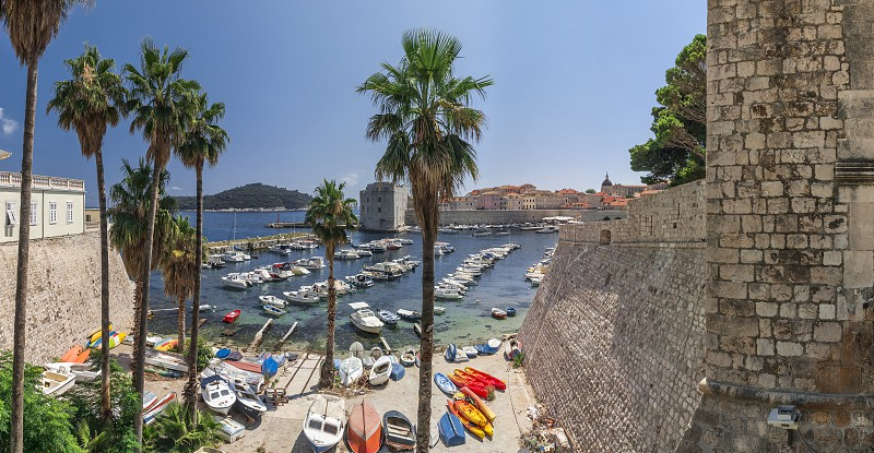 Dubrovnik Croatia - 07. 13. 2018. Fort St. Ivana and Old Port in Dubrovnik Croatia panoramic view on a sunny summer day. photo