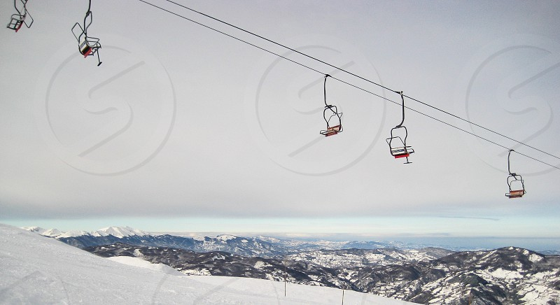 cable car on top of snowy mountain photo