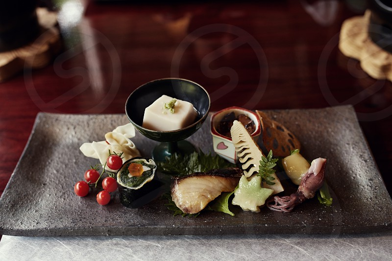 Traditional Kaiseki dinner course of tofu vegetables and seafood plated beautifully in Kyoto Japan. photo