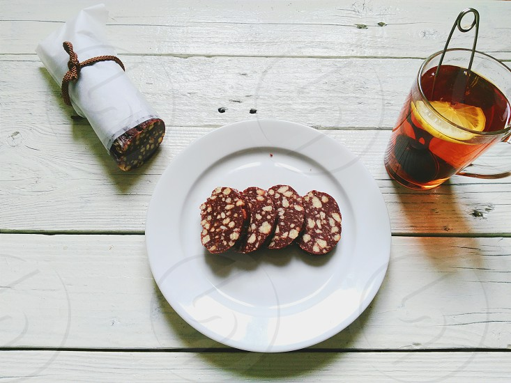 white ceramic platter with brown muffin with nuts photo