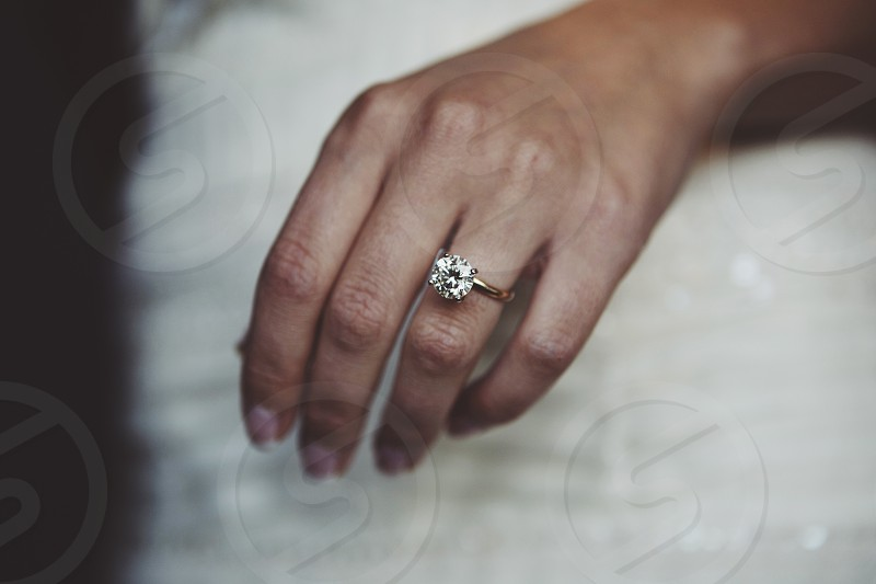 close up of wedding ring on brides hand photo