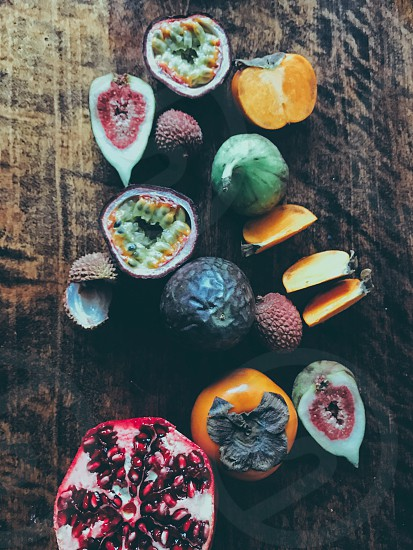 Fruits passion fruit  figs persimmon  pomegranate  photo
