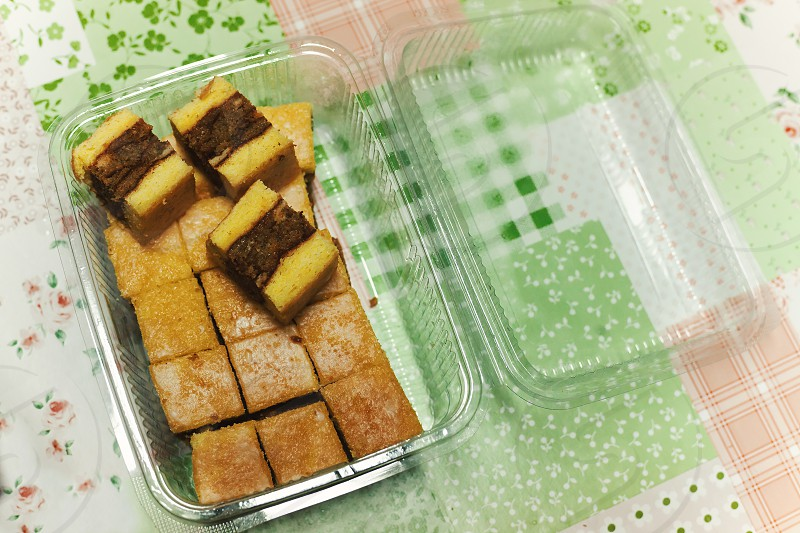 Details of homemade cakes in plastic transparent package. photo