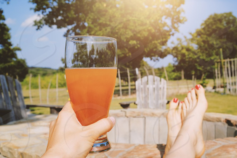Relaxing with drink and feet up during summer. photo