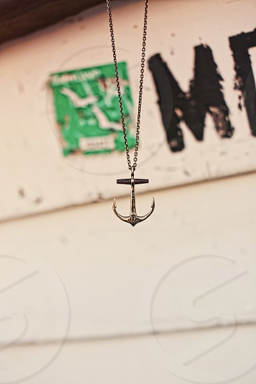 close up photo of silver anchor pendant necklace photo