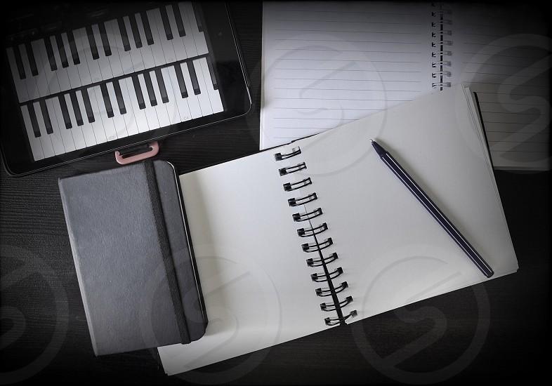 white binder on table photo