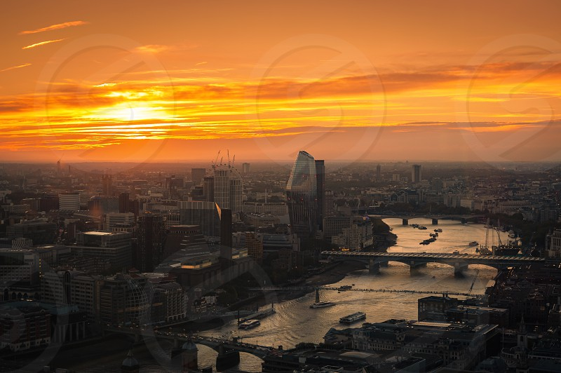 View at  London and busy thames river during sunset from Sky Garden Terraces. photo