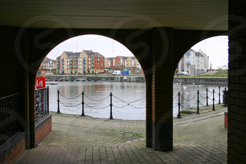 arches of building near pond photo
