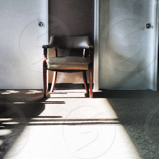 brown wooden padded chair photo