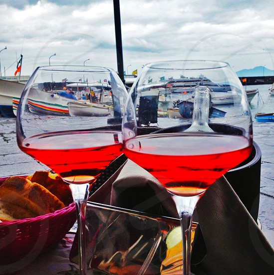 Romantic view over the harbour with two wine glasses photo