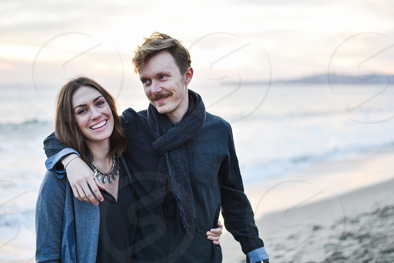 young adult couple at beach photo
