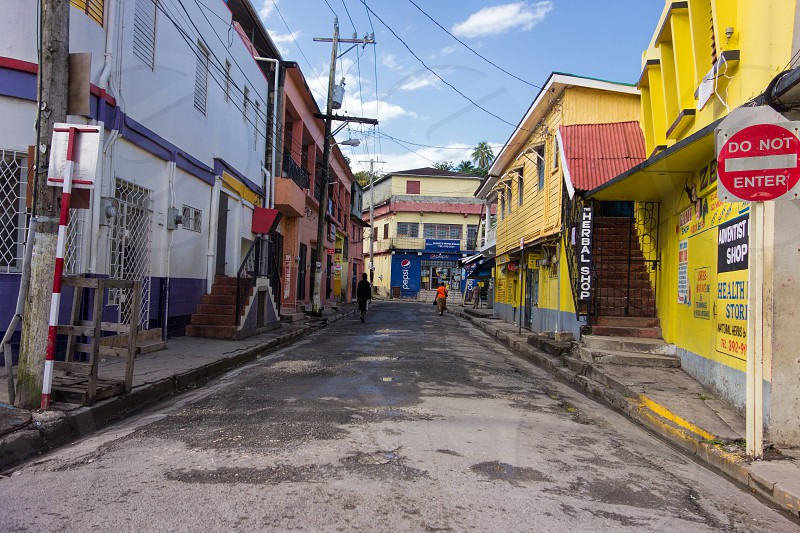 Port Antonio Jamaica – January 1 2014: Unidentified people walking on the colorful streets of downtown Port Antonio Jamaica on New Year's Day morning 2014.  photo