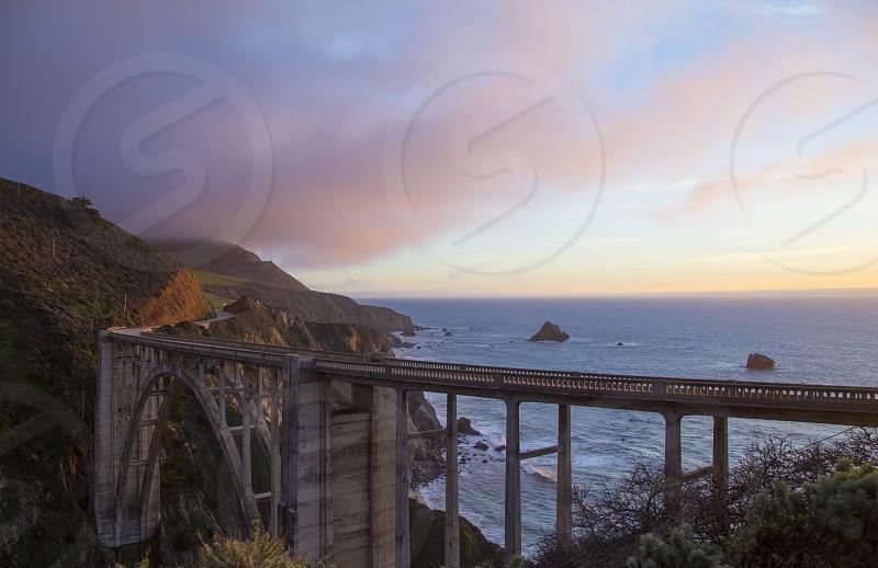 Big Sur travel clouds sunset travel explore create pink sky beach bridge photo