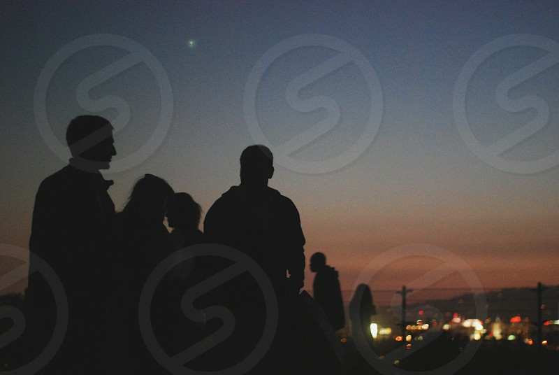 sunset silhouettes and city lights. photo