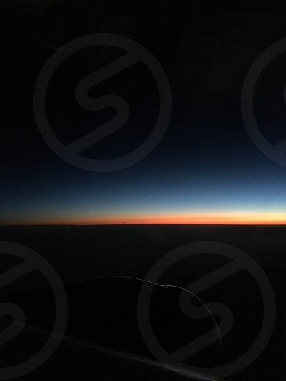 Sunset from Iceland air plane.   Destination Toronto  photo
