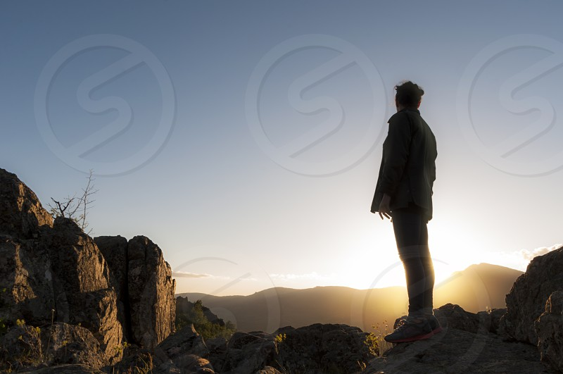 woman girl young silhouette backlit climber climbing sport top mountain effort sky sunset sunrise horizontal photo