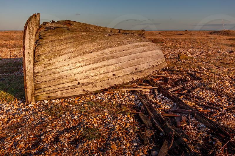DUNGENESS KENT/UK - DECEMBER 17 :  Derelict Rowing Boat on Dungeness Beach in Kent on December 17 2008 photo