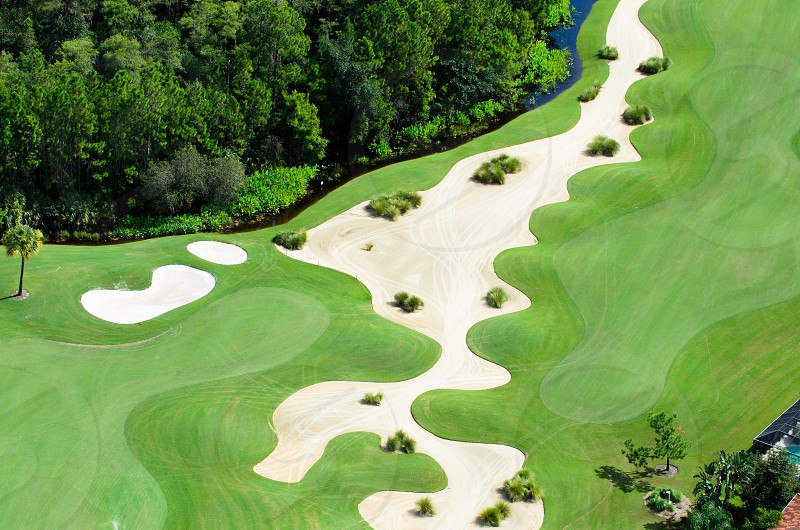 A golf course fairway in Florida.  Taken by helicopter at 500 feet. photo