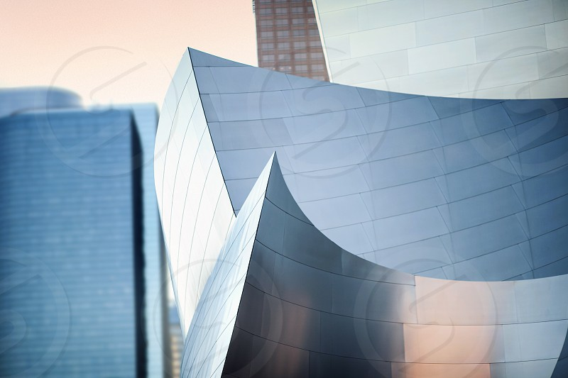 A semi-abstract detail of the Disney Concert Hall with a soft Los Angeles office building in the background. photo