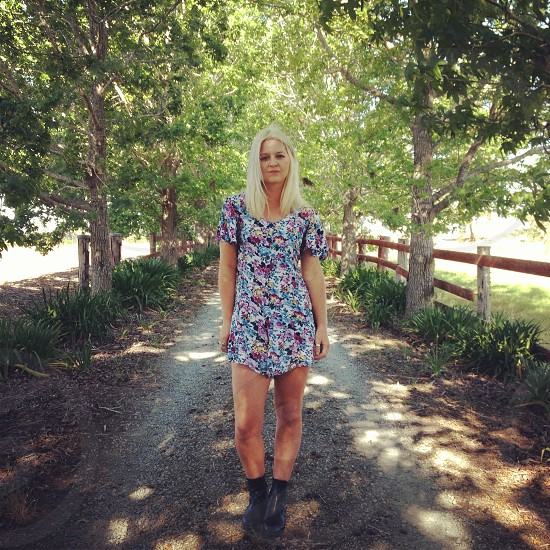 person wearing a blue and red floral printed dress photo