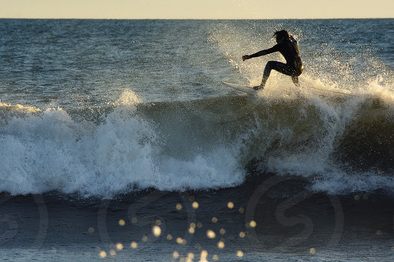 Sunset session at Point Dume CA  Surf surfer sport activity water ocean action fun  No Model Release subject is not recognizable. photo