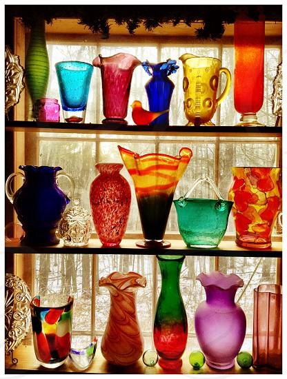 Backlit colorful glass  bottles photo