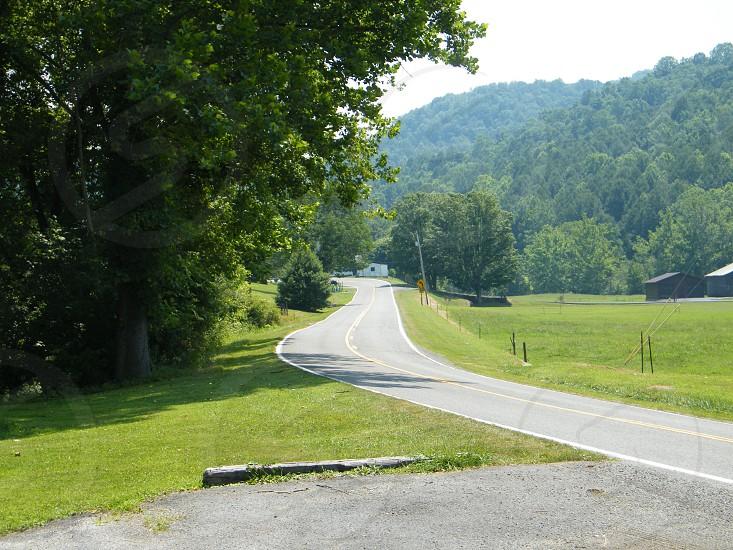 country road through mountains photo