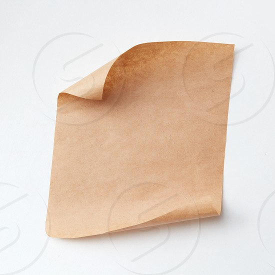 old craft paper piece isolated on white background with copy space photo