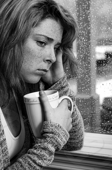 Love Sickness //#lady #girl #20's #staring out window #tea #letter #sitting on bench #sad #pensive #rain photo